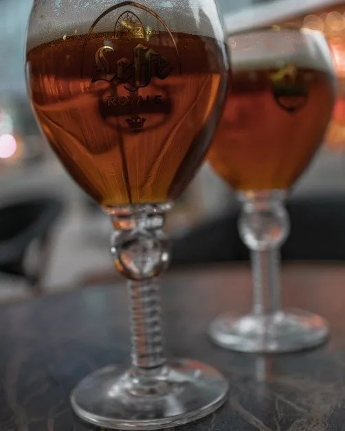 two pints of Belgian beer on a table in Brussels a female solo travel destination