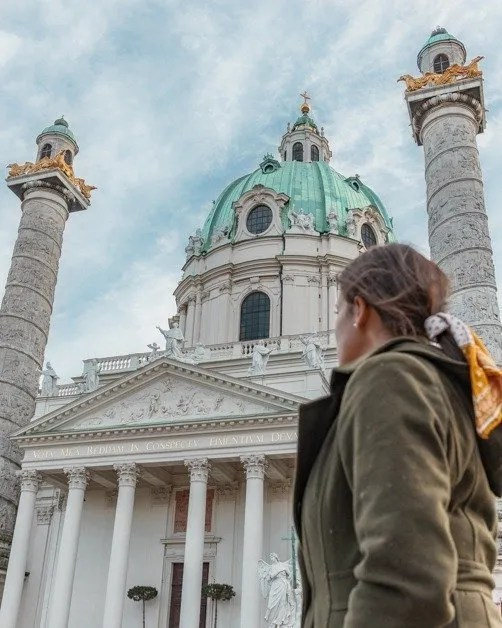 Me standing in from of St Charle's Church in Vienna top solo female travel destinations