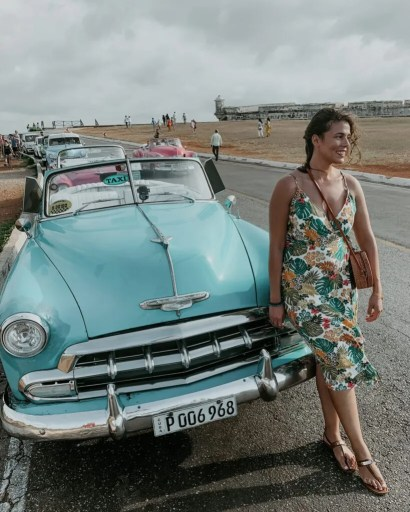 me posing in front of a classic car in havana