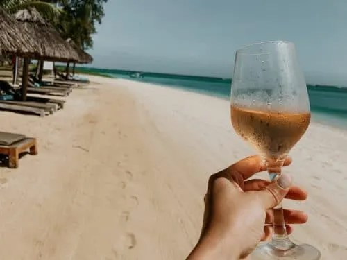 picture of a glass of rose at the beach in Mauritius