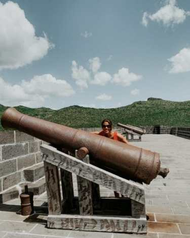 me posing with one of the canons at the fort in Port Louis