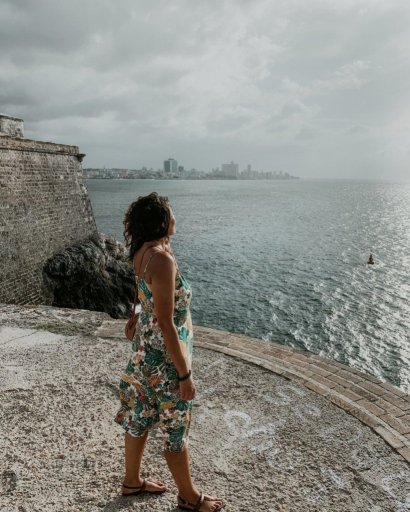 me standing over looking at the ocean at de los tres reyes del morro one of the most memorable things to do in Havana