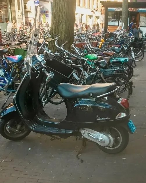 Motorcycles aligned in Amsterdam