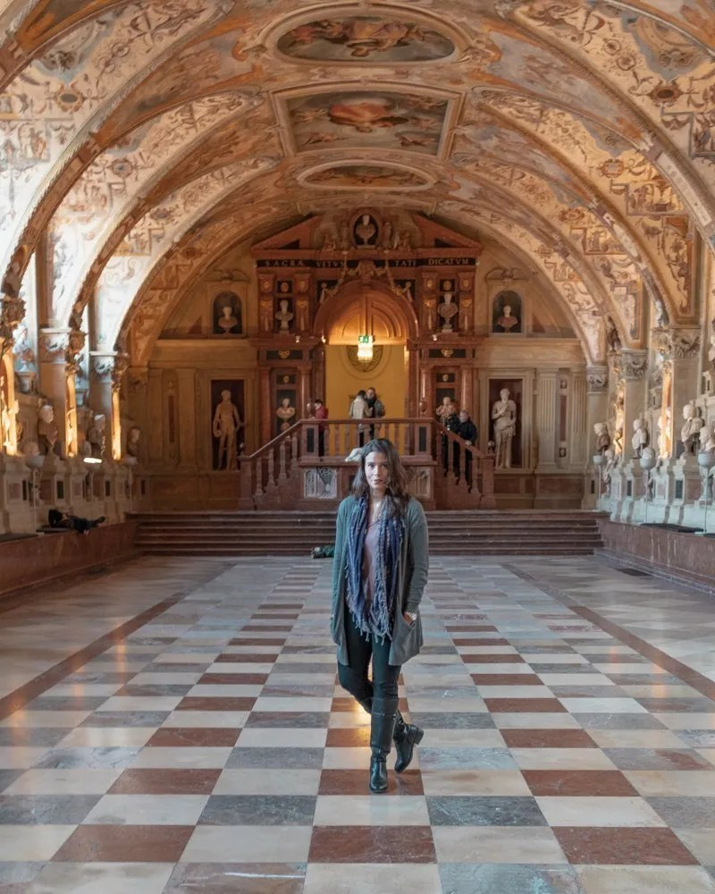 Me standing in a hallway at Munich Residenz.