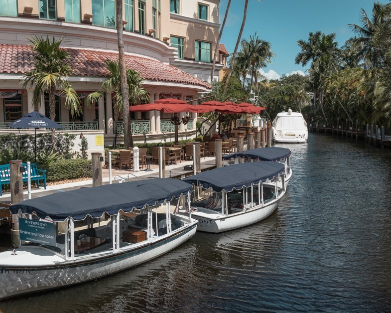 Picture of the Las Olas Gondola Tours gondola's sitting on the canal.