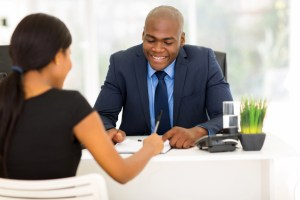 african woman signing employment contract