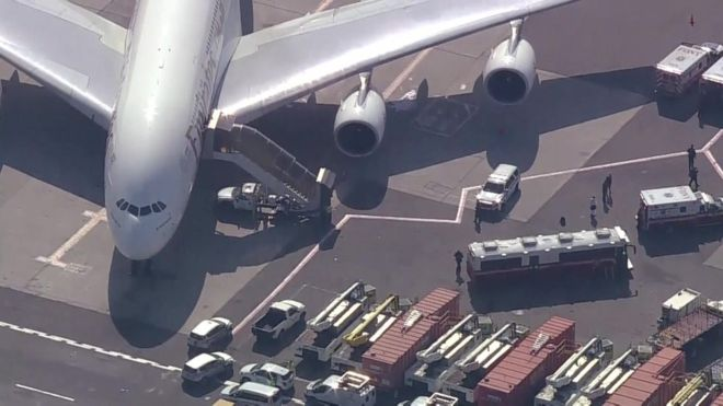 Emirates Airline: The passengers are being checked out by health professionals PHOTO: CBS