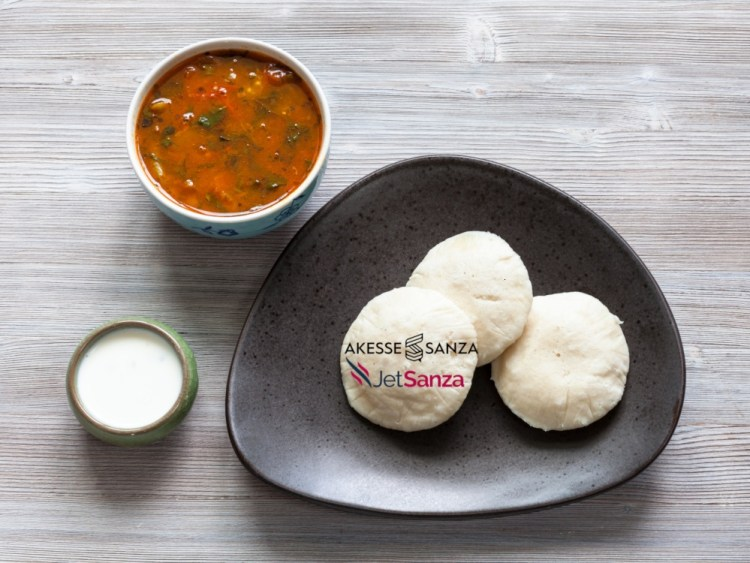 Indian cuisine - Idli Sambar steamed rice and urad bean dal dumplings served with sambar and chutney sauces on wooden table