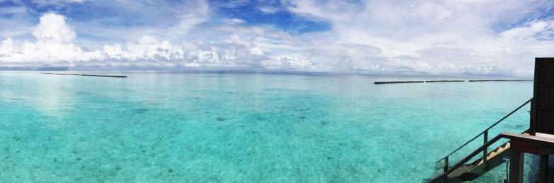 view from private deck of water villa veligandu island resort