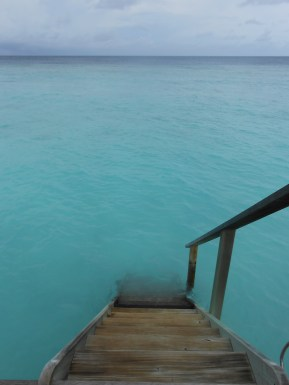 steps into water from water villa veliigandu island resort