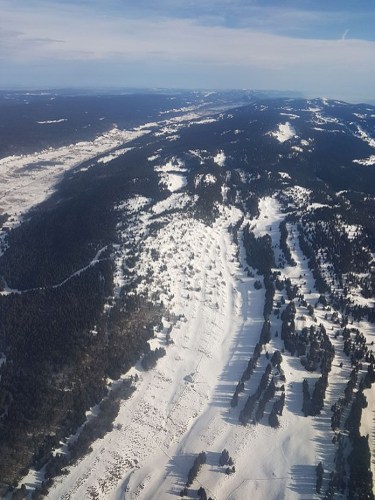 view of Geneva from plane on the way to Crystal Ski Holidays Ski Trip