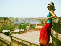 Alyssa dons a coral maxi skirt in India. Adding a bright traditional piece to your wardrobe is arguably the perfect souvenir. When traveling, seek out fabrics that remind you of cities you love, from crisp whites and electric blues of China to the rich purples and greens of Latin American textiles. When styling bright colors, start with two shades that complement each other well and build from there, adding more pops of color depending on how funky you're feeling. Shop Alyssa's look.