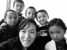 Traveler with local children