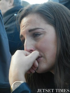 A woman mourns in tears