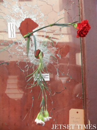 Flowers placed on bullet holes