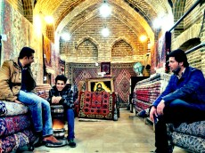 Young men selling rugs at the bazaar in Shiraz.