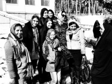 A group of young girls eager to take a photo with an Asian outside of Palace of Golestan and Sa'dabad.