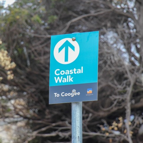 Bondi to Coogee Coastal Walk sign post on trail near Sydney, Australia