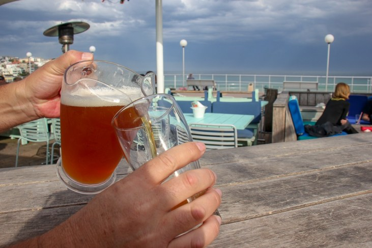 Pouring a beer at Bucket List on Bondi Beach, Sydney, Australia