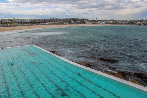 Swimmers doing laps at Icebergs Ocean Pool in Bondi, Australia