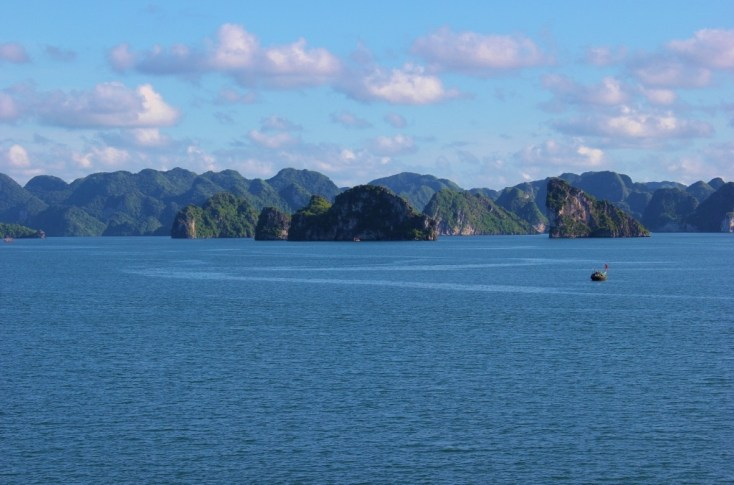 First glimpse of karst mountains on our Halong Bay Cruise in Vietnam