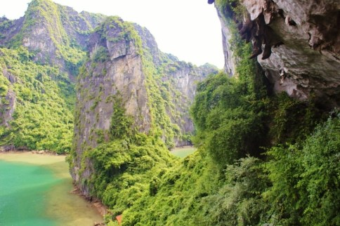 Tree-covered karsts at Amazing Cave in Halong Bay, Vietnam