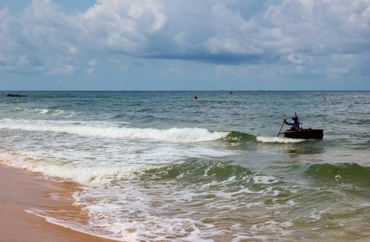Fisherman in round boat coming ashore Long Beach on Phu Quoc, Vietnam