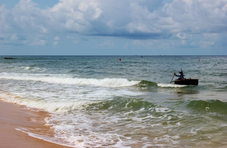 Fisherman in round boat coming ashore Long Beach on Phu Quoc, Vietnam