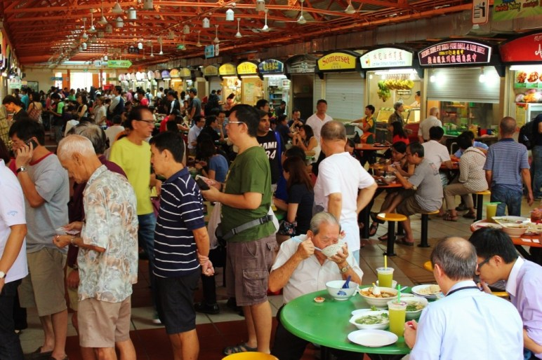 Long line at hawker stall at Maxwell Food Center in Chinatown, Singapore