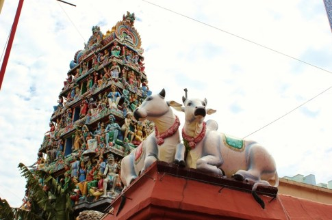 Cow statues and decorative gopura at Sri Mariamman Temple in Chinatown, Singapore