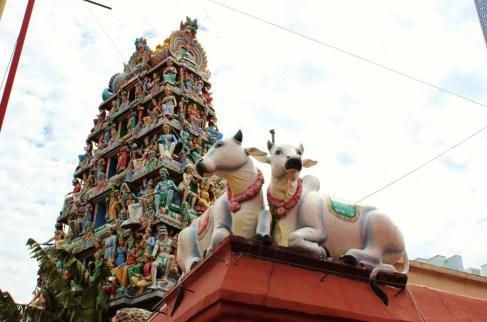 Cow statues and decorative gopura at Sri Mariamman Temple in Chinatown, Singapore