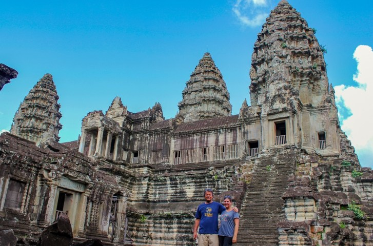 Standing inside Angkor Wat courtyard by towers at Angkor Park in Siem Reap, Cambodia