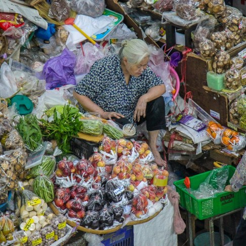 Woman vendor selling goods at Ton Lam Yai Market in Chiang Mai, Thailand