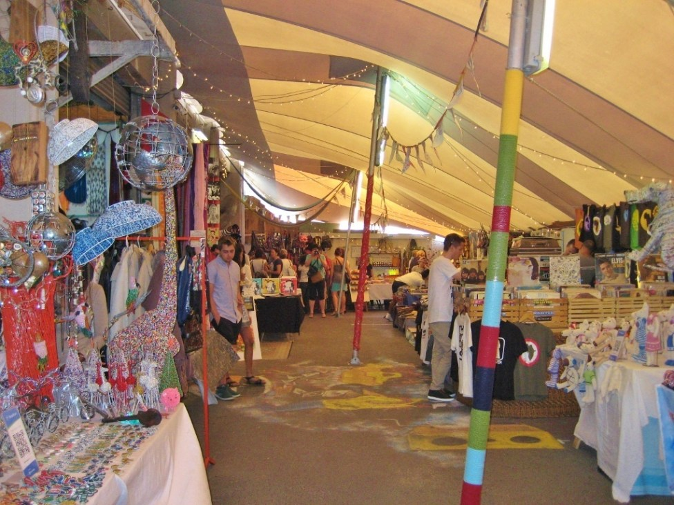 Stalls sell handmade crafts and goods at Hout Bay Market in Hout Bay, Cape Town, South Africa