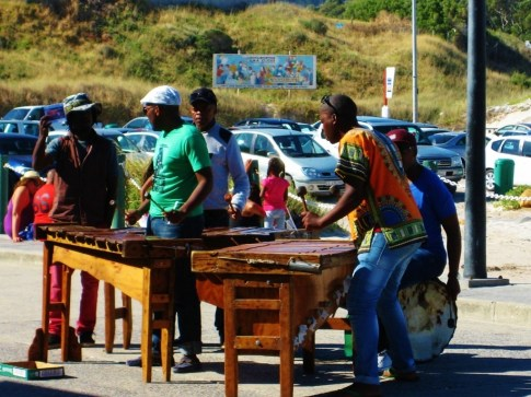 Street musicians and play, sing and dance for tips in Hout Bay, Cape Town, South Africa