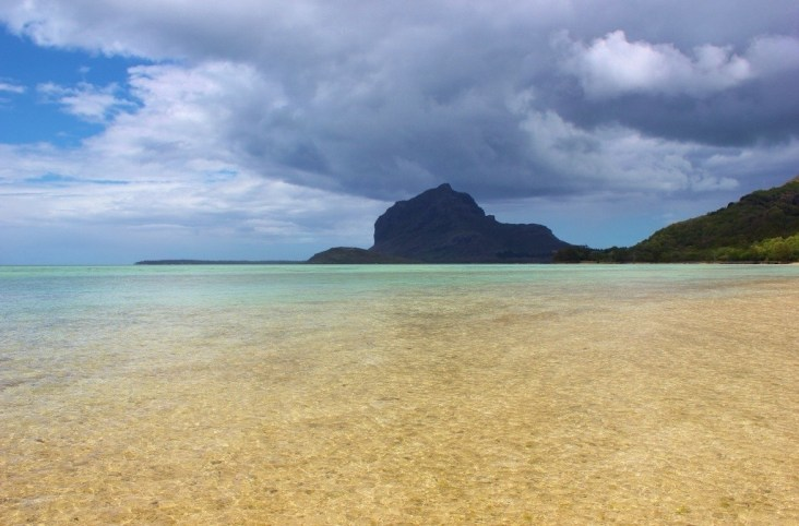 Shallow lagoon and Brabant Mountain in Le Morne, Mauritius