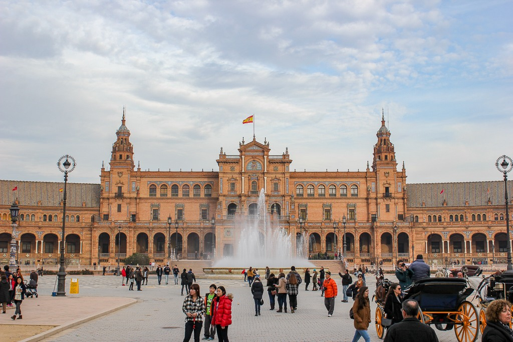 Visitors taking in the impressive view of Plaza de Espana, Seville Spain