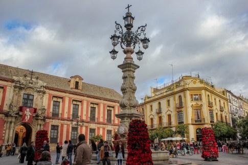 Festitive scene in Plaza de la Virgen de los Reyes, Seville Spain