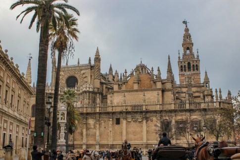 Crowds taking photos in Plaza del Triunfo, Seville Spain