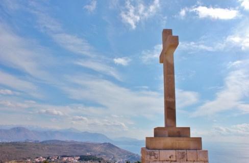White stone cross on top of Mount Srd in Dubrovnik, Croatia