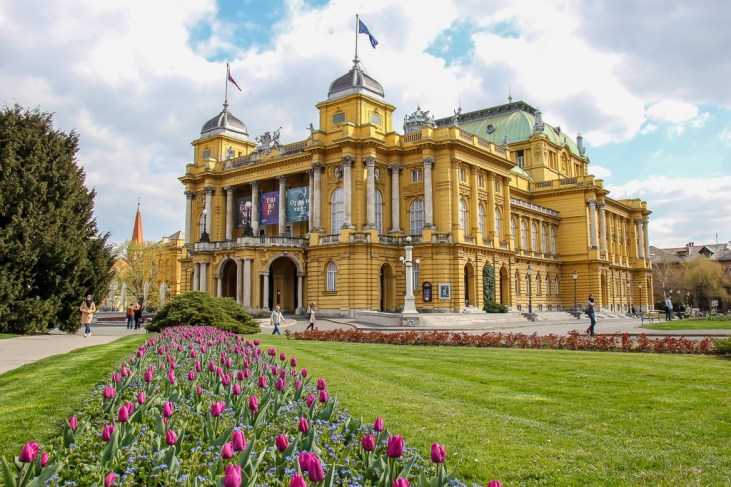 Flowers line walkway to Croatia National Theater in Zagreb, Croatia