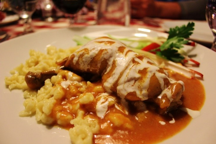 Friends in Budapest: Tasting traditional Hungarian food, the popular Chicken Paprika