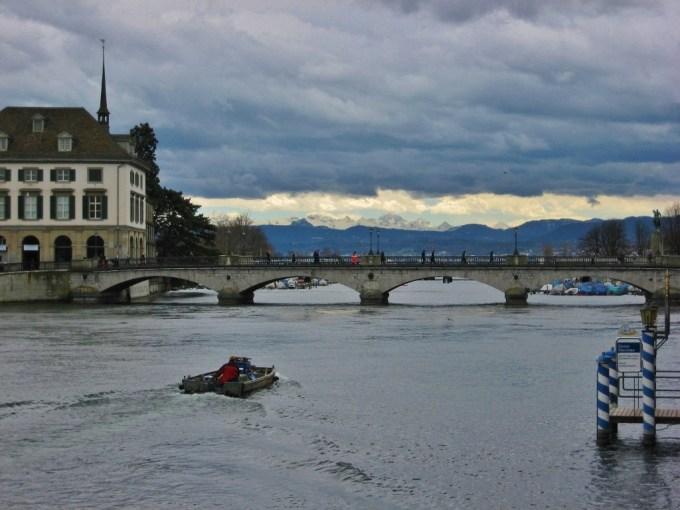 River Limmat and distant Alps, Zurich, Switzerland JetSettingFools.com
