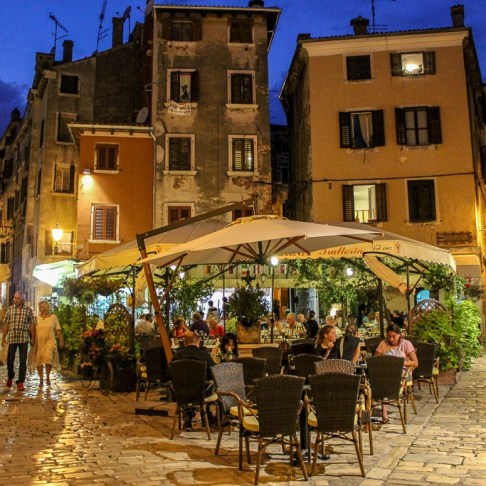 Busy cafe at night in Rovinj, Croatia