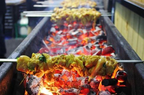 Meat roasts over hot coals at the Queen Victoria Night Market