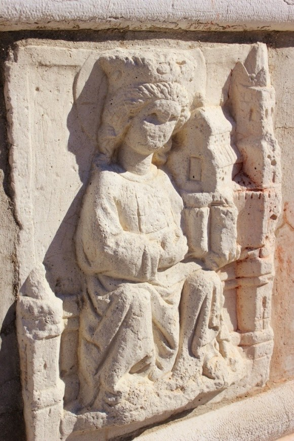 A stone carving of St. Euphemia near the church's side door.