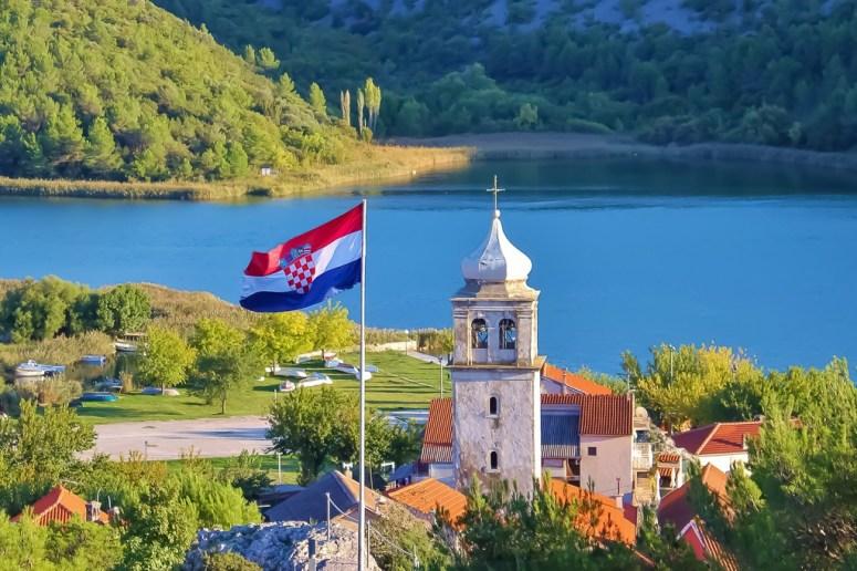 Croatia flag flies from hilltop in Skradin, Croatia
