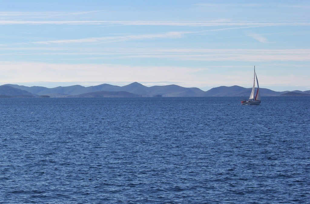 Lone sailboat on Adriatic Sea in Zadar Archipelago, Croatia