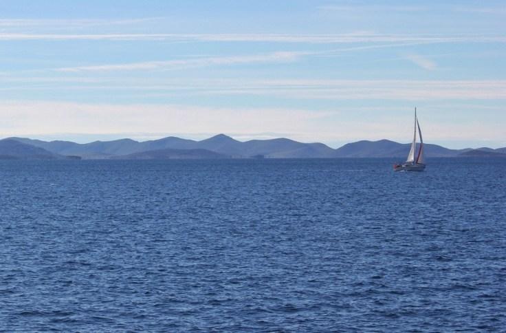 Lone sailboat on Adriatic Sea in Zadar Archipelago, Croatia