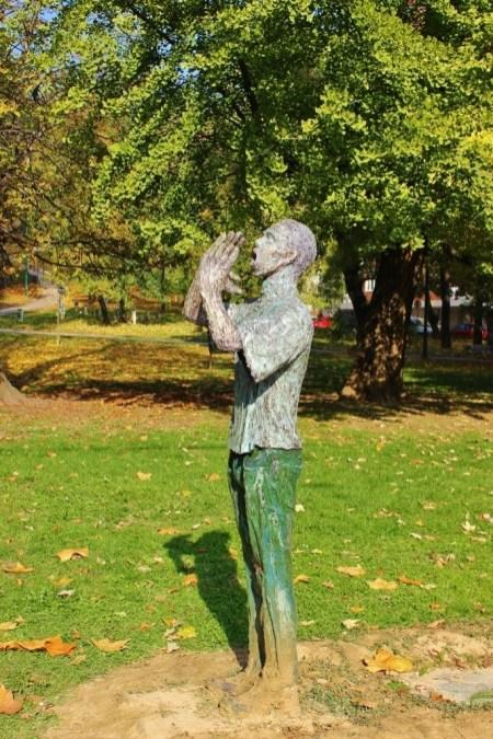 Srebrenica Monument: Man Calling To Son in Sarajevo, BIH